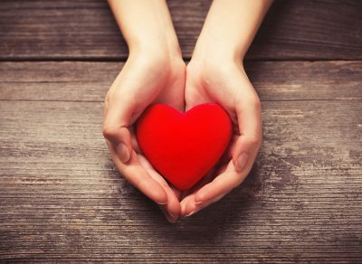 Female hands giving red heart; Shutterstock ID 247059397; Purchase Order: -